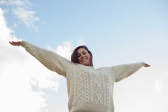 Woman in white sweater stretching her arms against sky Royalty Free Stock Photography