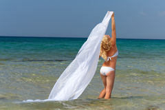 Woman in white swimsuit and plume in sea water Royalty Free Stock Photo