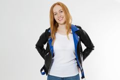 Woman in white t shirt and black leather jacket isolated on white background. Red hair girl in fashion clothes front view. Blank royalty free stock images