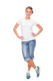 Woman in white t-shirt, shorts and jogging shoes Stock Photo