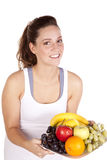 Woman in white tank top holding fruit plate royalty free stock images