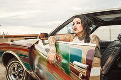 Woman With White Tank Top Inside Classic Multicolored Car Royalty Free Stock Photography