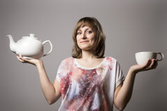 Woman with white tea cup and tin Royalty Free Stock Photography