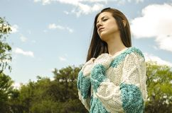 Woman in White and Teal Crochet Dress Under Cloudy Sky royalty free stock image