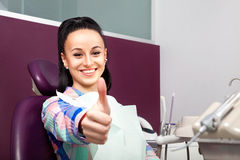 Woman with white teeth with thumb up waiting for dentist Royalty Free Stock Images