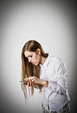 Woman in white with telephone Royalty Free Stock Photography