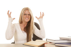 Woman white top books frustrated Royalty Free Stock Photo