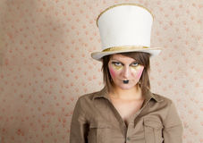 Woman in white top hat and a creative makeup Royalty Free Stock Image