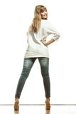 Woman in white top high heels shoes back view Royalty Free Stock Photos