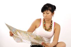 Woman white top plans her travel Royalty Free Stock Photo