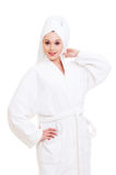 Woman in white towel and bathrobe Stock Photos