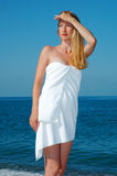 Woman in a white towel at coast Royalty Free Stock Photography