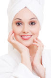 Woman with white towel on her head Stock Images