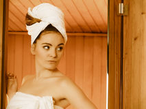 Woman white towel in sauna room Stock Image