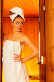 Woman white towel in sauna room Royalty Free Stock Images