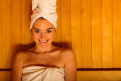 Woman white towel in sauna room Stock Photo