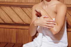 Woman in white towel in a sauna Stock Photos