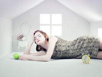 Woman in the white toy house Royalty Free Stock Image
