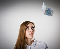 Woman in white and twenty Euro. Royalty Free Stock Images