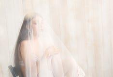 Woman in white underwear. Stock Photos