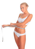 Woman in white underwear with tape measure Royalty Free Stock Image