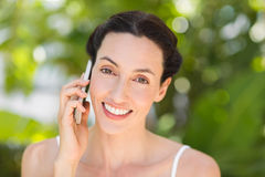 woman in white using her phone Stock Photo