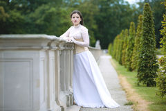 Woman in white Victorian dress Stock Image