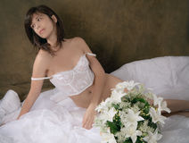 Woman in White Vintage Lingerie on Bed Stock Photos
