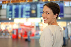 Woman in white wear in hall of airport Stock Photos