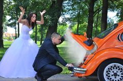 Woman in White Wedding Gown Near Orange Car Royalty Free Stock Image