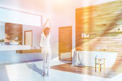 Woman in white and wood bathroom corner stock photos