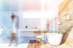 Woman in white and wood bathroom interior stock photos