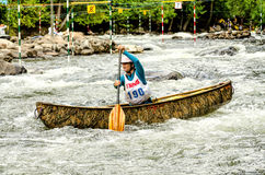 Woman in a whitewater canoe Stock Image