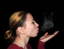 Woman who blows water out of her mouth Stock Images