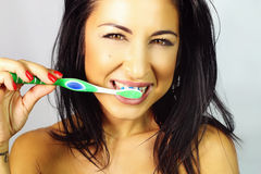 Woman Who Is Brushed Teeth Smiling. Beautiful young woman who is brushed teeth smiling royalty free stock photo