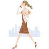 Woman who calls while walking Royalty Free Stock Photos