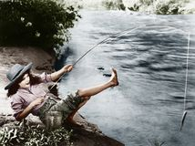 Woman Who Caught A Small Fish Falling Over Backwards Royalty Free Stock Image