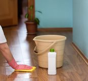 Floor cleaning. The woman who cleaned the house. Floor cleaning. Surface wiping work with cloth Royalty Free Stock Photo