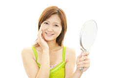 The woman who is doing skin care. Stock Images