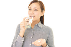 Woman who drink supplements Stock Photo