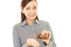 Woman who drink supplements Stock Photos