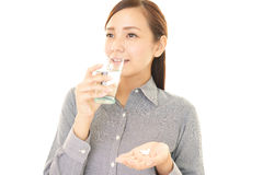 Woman who drink supplements Royalty Free Stock Photography