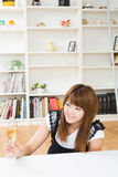 The woman who drinks wine Stock Image