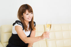 The woman who drinks wine Stock Photography