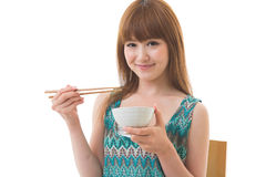 The woman who eats. The young woman who eats Stock Photo