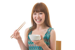 The woman who eats. The young woman who eats Stock Images