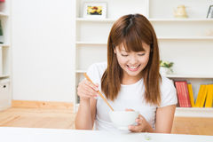 The woman who eats. The young woman who eats in a room Stock Photography
