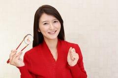 Japanese woman eating sushi. Woman who eats sushi roll stock photo