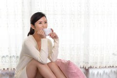 Woman who enjoys the coffee break Royalty Free Stock Images