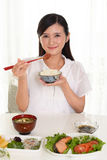 Woman who enjoys Japanese food Royalty Free Stock Images